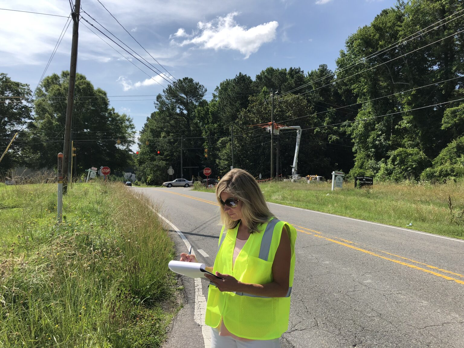 Brittany Chase conducting field work for Olive Branch traffic engineering project
