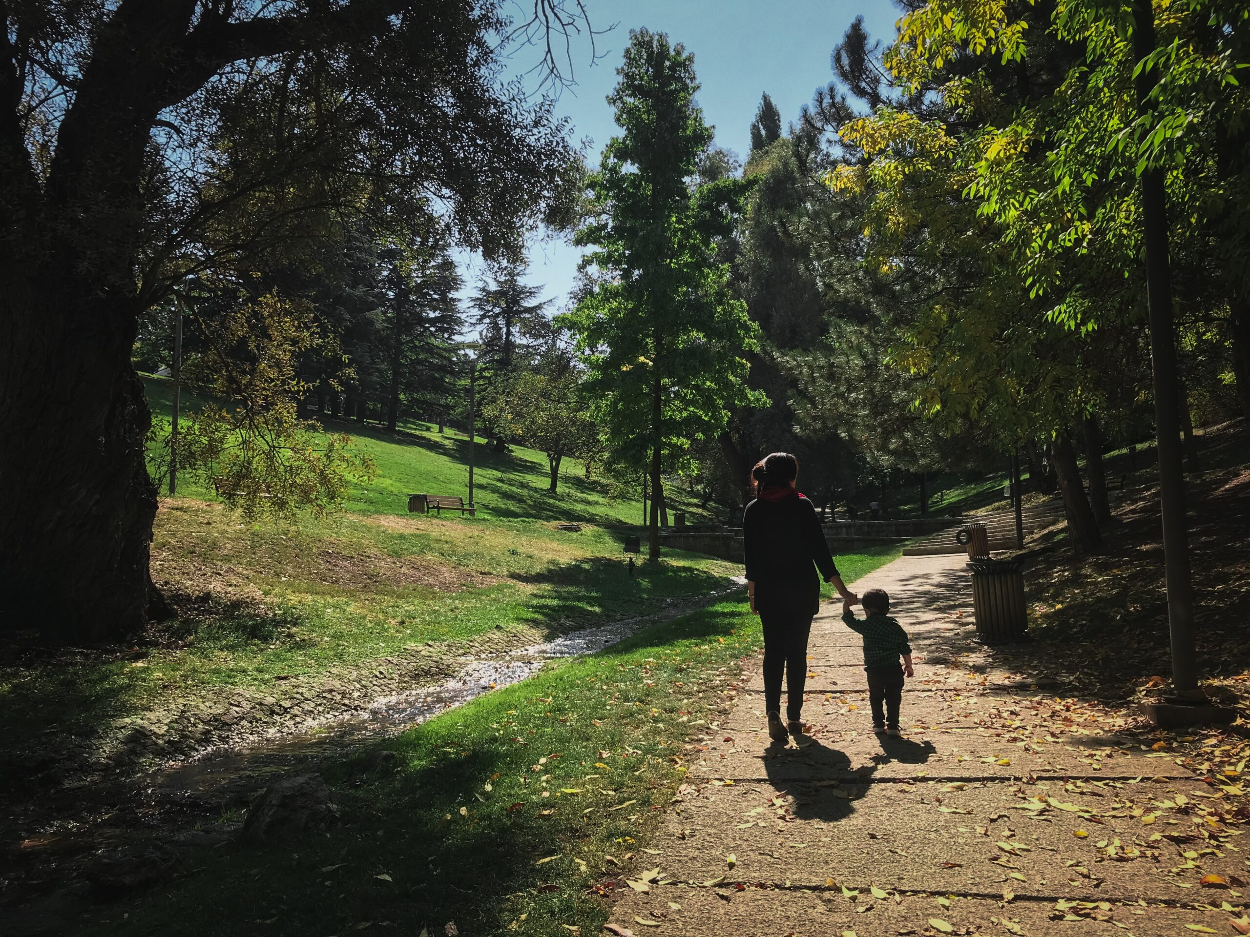 Parent and child walk on a greenway